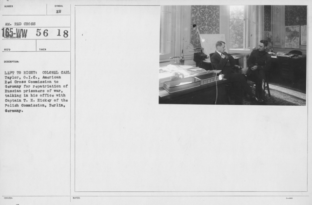 American Red Cross - Groups - Left to right: Colonel Carl Taylor, O.I.C., American Red Cross Commission to Germany for repatriation of Russian prisoners of war, talking in his office with Captain T.H. Hickey of the polish Commission, Berlin, Germany