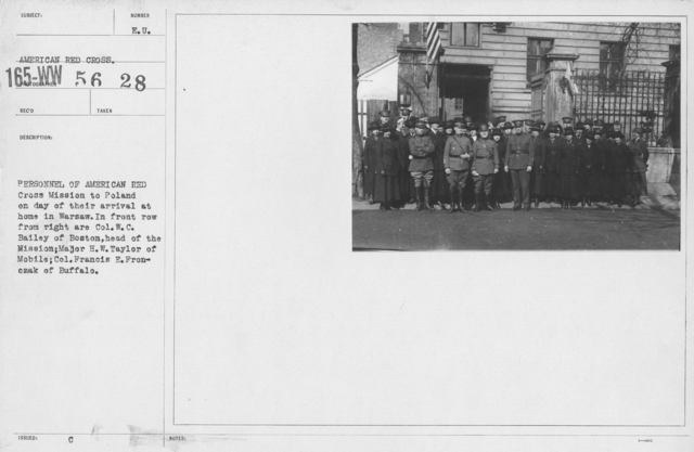 American Red Cross - Groups - Personnel of American Red Cross Mission to Poland on day of their arrival at home in Warsaw. In front row from right are Col. W.C. Bailey of Boston, head of the Mission; Major H.W. Taylor of Mobile; Col. Francis E. Frontczak of Buffalo