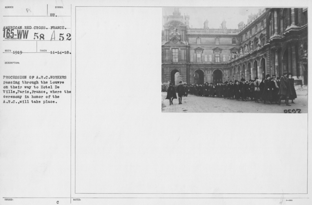American Red Cross - Groups - Procession of A.R.C. workers passing through the Louvre on their way to Hotel De Ville, Paris, France, where the ceremony in honor of the A.R.C. will take place