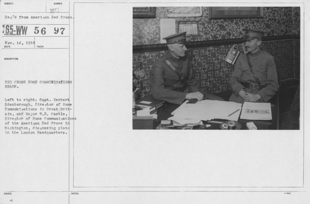 American Red Cross - Groups - Red Cross Home Communications Heads. Left to right: Capt. Herbert Edenborough, Director of Home Communications in Great Britain, and Major W.R. Castle, Director of Home Communications of the American Red Cross in Washington, discussing plans in the London Headquarters