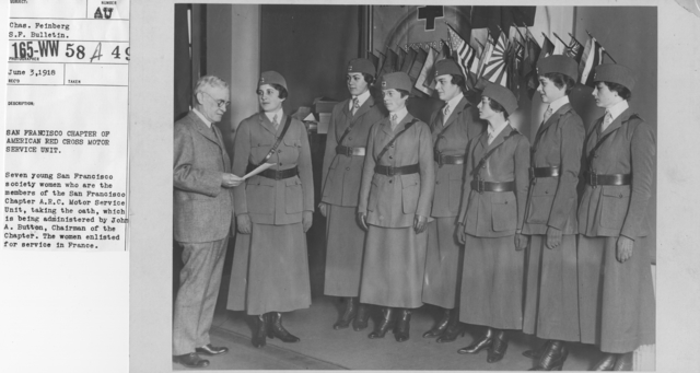 American Red Cross - Groups - San Francisco Chapter of American Red Cross Motor Service Unit. Seven young San Francisco society women who are the members of the San Francisco Chapter A.R.C. Motor Service Unit, taking the oath, which is being administered by John A. Button, Chairman of the Chapter. The women enlisted for service in France