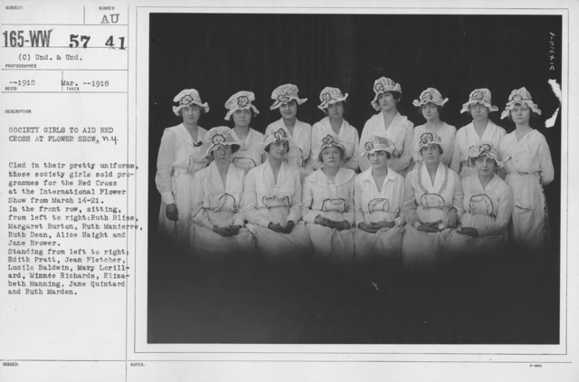 American Red Cross - Groups - Society girls to aid Red Cross at Flower Shower, N.Y. Clad in their pretty uniforms, these society girls sold programmes for the Red Cross at the International Flower Show from March 14-21. In the front row, sitting, from left to right: Ruth Bliss, Margaret Burton, Ruth Manierre, Ruth Dean, Alice Haight and Jane Brower. Standing from left to right: Edith Pratt, Jean Fletcher, Lucile Baldwin, Mary Lorillard, Minnie Richards, Elizabeth Manning, Jane Quintard and Ruth Marden