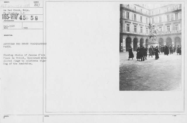 American Red Cross - Headquarters & Buildings - American Red Cross Headquarters Paris. Showing statue of Jeanne D'Arc Place de Rivoli, decorated with Allied Flags to celebrate signings of the Armistice