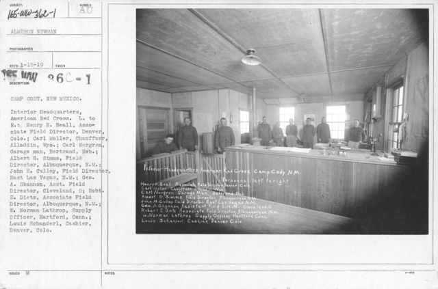 American Red Cross - Headquarters & Buildings - Camp Cody, New Mexico. Interior Headquarters, American Red Cross. L. to R.: Henry H. Beall, Associate Field Director, Denver, Colo.; Carl Moller, Chauffuer, Alladdin, Wyo.; Carl Norgren, Garage man, Bertrand, Neb.; Albert G. Simms, Field Director, Albuquerque, N.M.; John H. Culley, Field Director, East Las Vegas, N.M.; Geo. A. Shannon, Asst. Field Director, Cleveland, O; Robt. E. Dietz, Associate Field Director, Albuquerque, N.M.; W. Norman Lathrop, Supply Officer, Hartford, Conn.; Louis Schanderl, Cashier, Denver, Colo