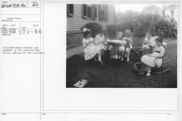 American Red Cross - Junior Red Cross - Children whose parents are members of the American Red Cross, sewing for the soldiers