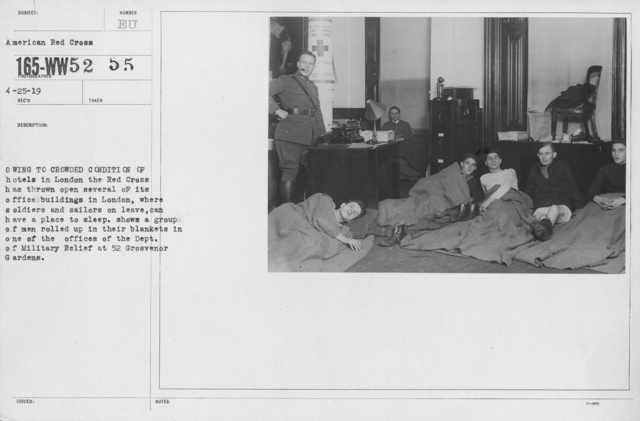 American Red Cross - Miscellaneous - Owing to crowded condition of hotels in London the Red Cross has thrown open several of its office buildings in London, where soldiers and sailors on leave can have a place to sleep. Shows a group of men rolled up in their blankets in one of the offices of the Dept. of Military Relief at 52 Grosvenor Gardens