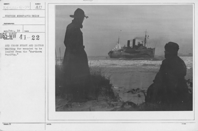 """American Red Cross - Miscellaneous - Red Cross Nurse and Doctor waiting for wounded to be landed from the """"Northern Pacific."""""""