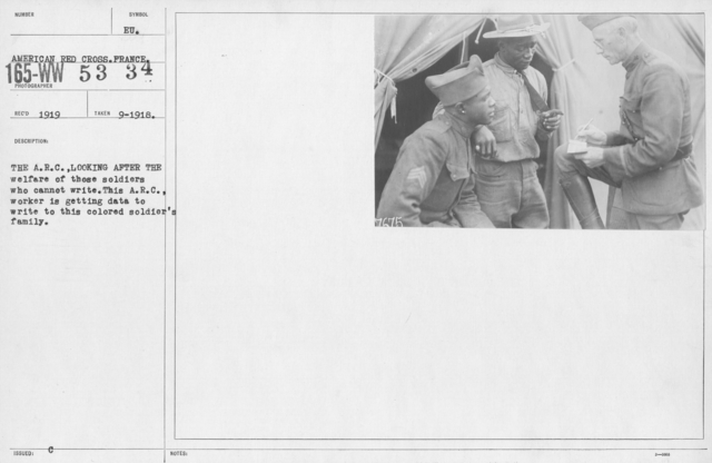 American Red Cross - Miscellaneous - The A.R.C. looking after the welfare of these soldiers who cannot write. This A.R.C. worker is getting data to write to this colored soldier's family