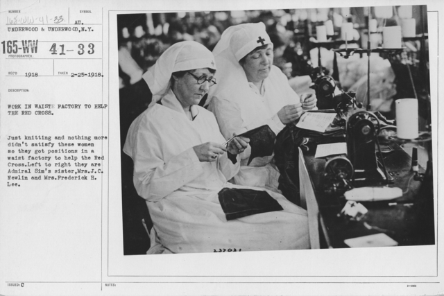 American Red Cross - Miscellaneous - Work in waiste factory to help the Red Cross. Just knitting and nothing more didn't satisfy these women so they got positions in a waist factory to help the Red Cross. Left to right they are Admiral Sim's sister, Mrs. J.C. Newlin and Mrs. Frederick J. Lee