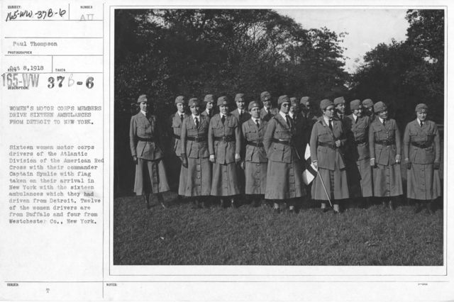 American Red Cross - Motor Car Service - Women's Motor Corps Members drive sixteen ambulances from Detroit to New York. Sixteen women motor corps drivers of the Atlantic drivers of the Atlantic Division of the American Red Cross with their commander Captain Symlie with flag taken on their arrival in New York with the sixteen ambulances which they had driven from Detroit. Twelve of the women drivers are from Buffalo and four from Westchester Co., New York