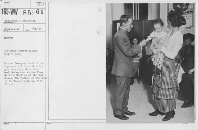 American Red Cross - N thru W - Japanese Prince shakes baby's hand. Prince Tokugawa head of the Japenese Red Cross Mission greeting baby Salvatore and its mother at the Home Service Section of the Red Cross. The father of the baby is in France with the U.S. forces