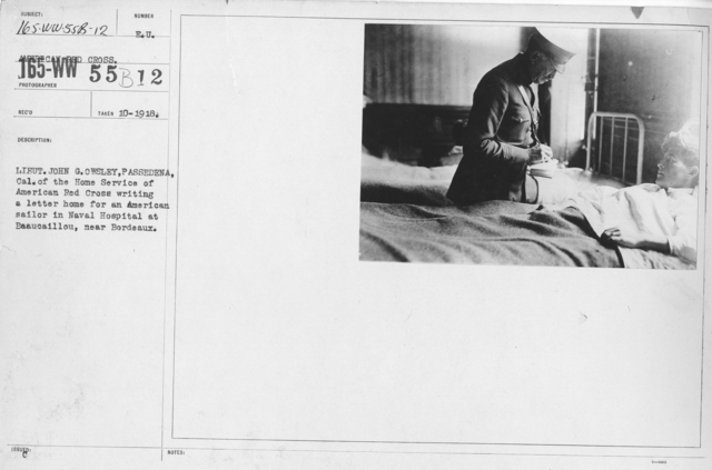 American Red Cross - N thru W - Lieut. John G. Owsley, Passedena, Cal. of the Home Service of American Red Cross writing a letter home for an American sailor in Naval Hospital at Beaucaillou, near Bordeaux