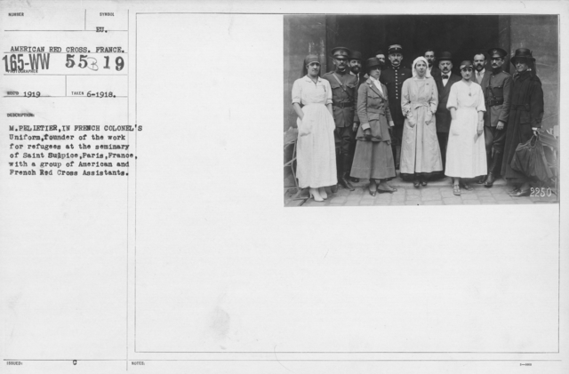 American Red Cross - N thru W - M. Pelietier, in French Colonel's Uniform, founder of the work for refugees at the seminary of Saint Sulpice, Paris, France, with a group of American and French Red Cross Assistants