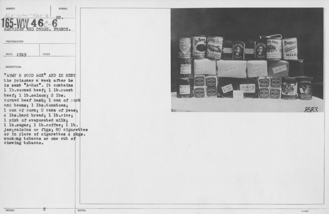 """American Red Cross - Prisoners of War - """"Army B Food Box"""" and is sent the prisoner a week after he is sent """"A Box."""" It contains 1lb corned beef; 1lb roast beef; 1lb salmon; 2lbs corned beef hash; 1 can of pork and beans; 1lb tomatoes; 1 can of corn; 2 cans of peas; 4lbs hard bread; 1lb rice; 1 pint of evaporated milk; 1lb sugar; 1lb coffee; 1lb jam; raisins or figs; 80 cigarettes or in place of cigarettes 4 pkgs smoking tobacco or one cut of chewing tobacco"""