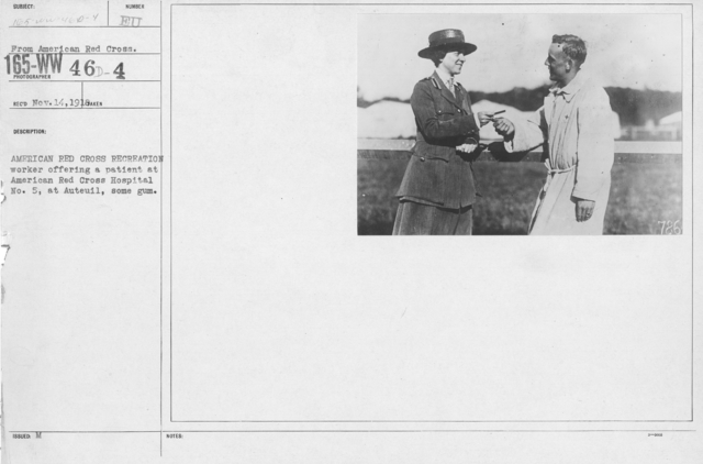 American Red Cross - Recreation and Sports - American Red Cross recreation worker offering a patient at American Red Cross Hospital No. 5, at Auteuil, some gum