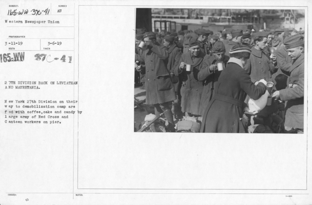 American Red Cross - Refreshments - 27th Division back on Leviathan and Mauretania. New York 27th Division on their way to demobilization camp are fed with coffee, cake and candy by large army of Red Cross and Canteen workers on pier
