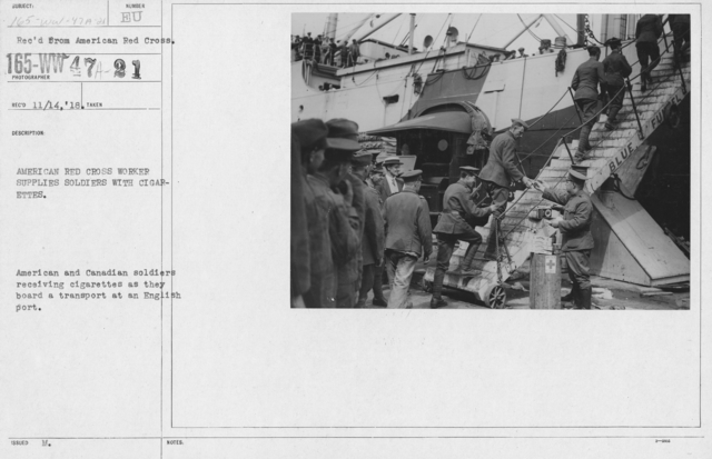 American Red Cross - Refreshments - Enroute - American Red Cross worker supplies soldiers with cigarettes. American and Canadian soldiers receiving cigarettes as they board a transport at an English port