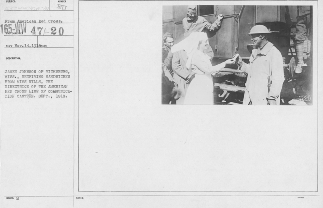 American Red Cross - Refreshments - Enroute - James Johnson of Vicksburg, Miss., receivign sandwiches from Miss Wills, the Directrice of the American Red Cross Line of Communication Canten. Sept. 1918