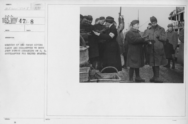 American Red Cross - Refreshments - Enroute - Members of Red Cross giving candy and cigarettes to boys just before debarking on S.S. Southampton for United States