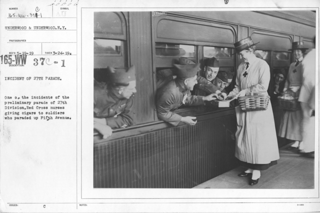 American Red Cross - Refreshments - Incident of 27th parade. One of the incidents of the preliminary parade of 27th Division, Red Cross nurses giving cigars to soldiers who paraded up Fifth Avenue