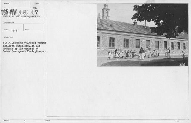 American Red Cross - Refugees - A.R.C. workers teaching French children games, etc. in the grounds of the convent at Sacre Coeur, near Paris, France