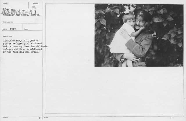 American Red Cross - Refugees - Capt. Bernard, A.R.C. and a little refugee girl at Grand Val, a country home for delicate refugee children, established by the American Red Cross