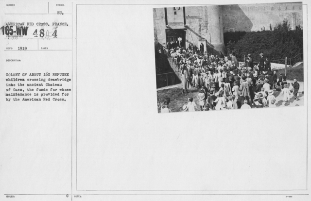 American Red Cross - Refugees - Colony of about 160 refugee children crossing drawbridge into the ancient Chateau of Caen, the funds for whose maintenance is provided by the American Red Cross