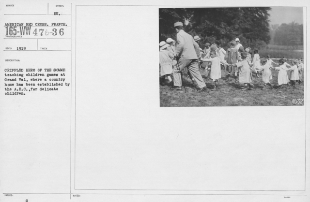 American Red Cross - Refugees - Crippled hero of the Somme teaching children games at Grand Val, where a country home has been established by the A.R.C. for delicate children