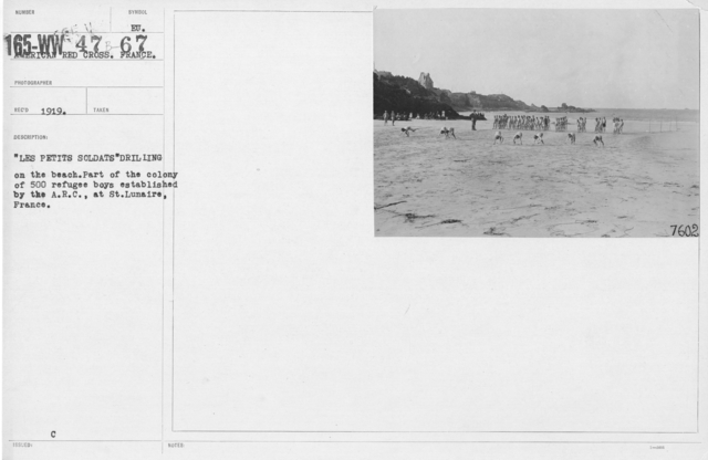 "American Red Cross - Refugees - ""Les Petits Soldats"" drilling on the beach. Part of the colony of 500 refugee boys established by the A.R.C. at St. Lunaire, France"