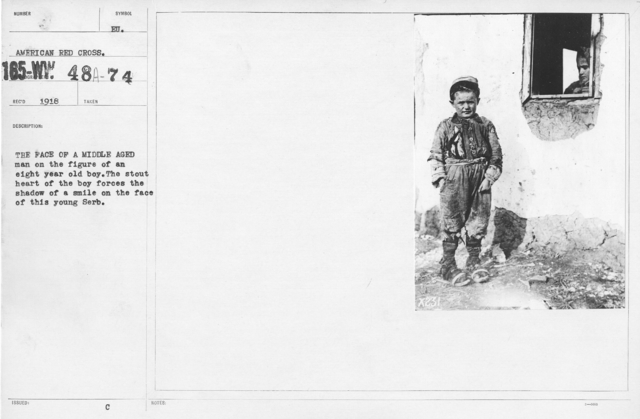 American Red Cross - Refugees - The face of a middle aged man on the figure of an eight year old boy. The stout heart of the boy forces the shadow of a smile on the face of this young Serb
