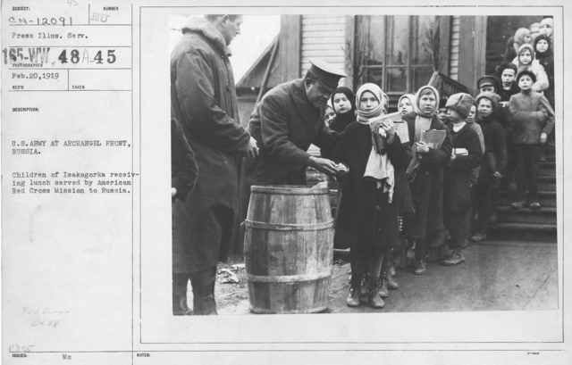 American Red Cross - Refugees - U.S. Army at Archangel Front, Russia. Children of Isakogorka receiving lunch erved by American Red Cross Mission to Russia