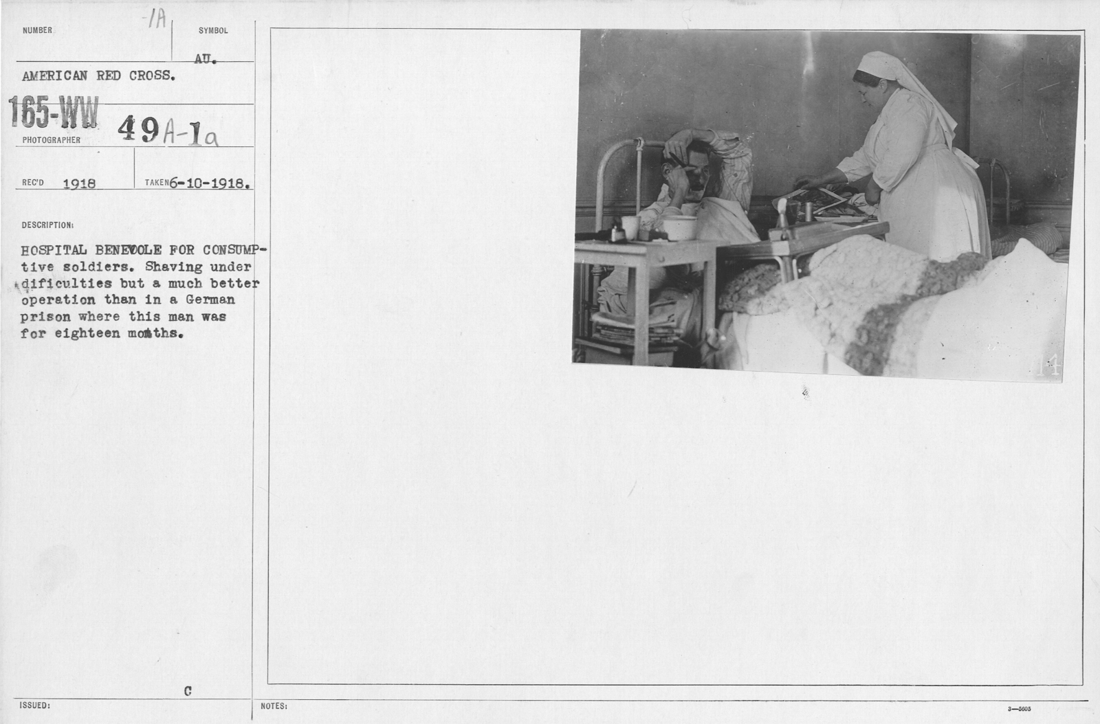 American Red Cross - Rehabilitation - Hospital Benevoole for Consumptive soldiers. Shaving under difficulties but a much better operation than in a German prison where this man was for eighteen months