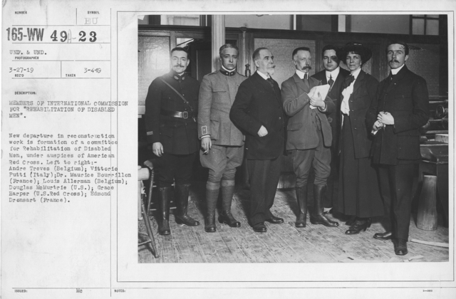 """American Red Cross - Rehabilitation - Members of International Commission for """"Rehabilitation of Disabled Men."""" New departure in reconstruction work is formation of a committee for Rebabilitation of Disabled Me, under auspices of American Red Cross. Left to Right: Andre Treves (Belgium); Vittorio Putti (Italy); Dr. Maurice Bourrillon (France); Louis Allerman (Belgium); Douglas McMurtire (U.S.); Grace Harber (U.S. Red Cross); Edmond Dronsart (France)"""