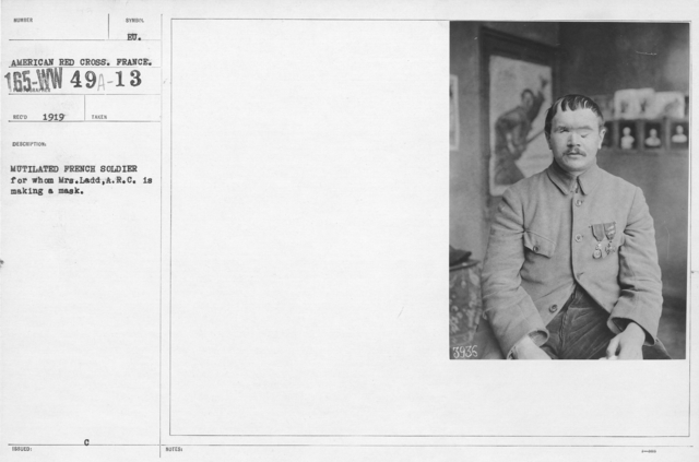 American Red Cross - Rehabilitation - Mutilated French soldier for whom Mrs. Ladd, A.R.C., is making a mask
