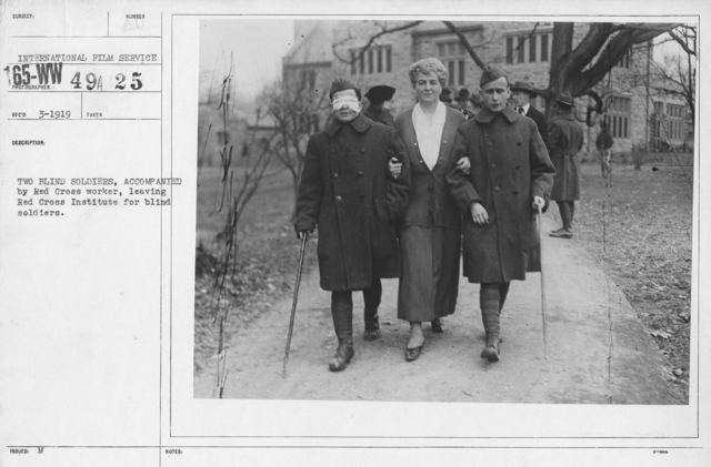 American Red Cross - Rehabilitation - Two blind soldiers, accompanied by Red Cross worker, leaving Red Cross Institute for blind soldiers
