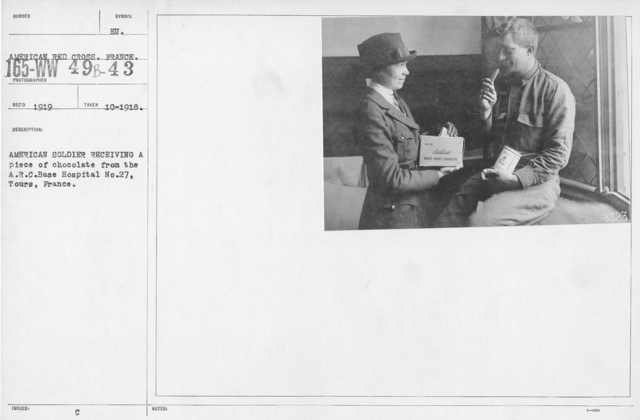 """American Red Cross - """"Second Aid"""" - American soldier receiving a piece of chocolate from the A.R.C. Base Hospital No, 27, Tours, France"""