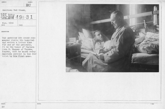 """American Red Cross - """"Second Aid"""" - The American Red Cross Commander visits the hospital and writes a letter home for one of the patients. It is the boase of Captain John E. Wagner of Topeka, Kansas, that he knows every American patient in his district by his first name"""