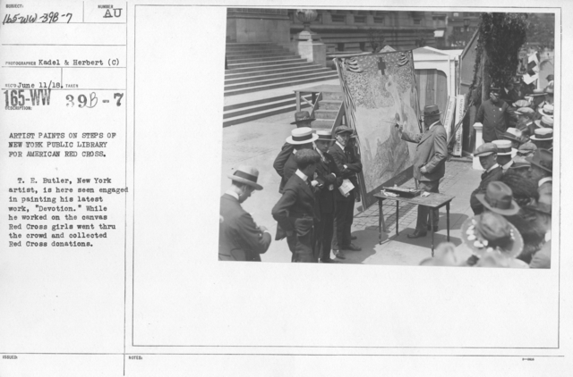 """American Red Cross - Soliciting Funds - Miscellaneous - Artist paints on steps of New York Public Library for American Red Cross. T. E. Butler, New York artist, is here seen engaged in painting his latest work, """"Devotion."""" While he worked on the canvas Red Cross girls went through the crowd and collected Red Cross donations"""