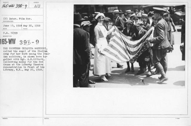 American Red Cross - Soliciting Funds - Miscellaneous - The Countess Chiquita Mazzuchi, called the angel of the Italian Army for her work among the Italian soldiers, is shown here together with Sgt. A.E. Gilbert, collecting money for the Red Cross at the Liberty Theatre demonstration in front of the Library, N.Y., May 20, 1918