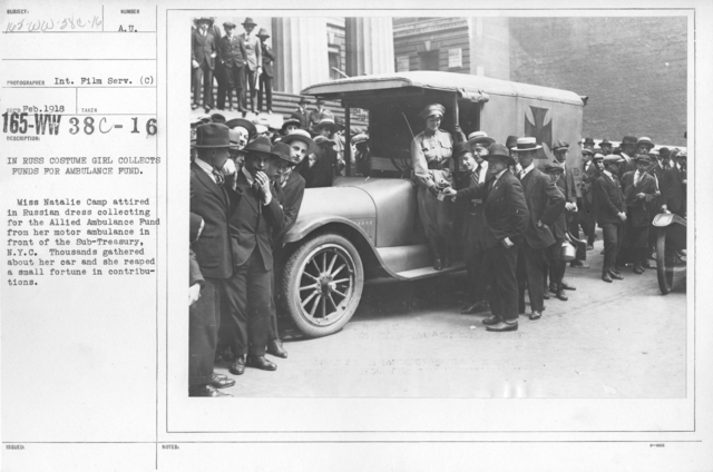 American Red Cross - Soliciting Funds - Personal Appeal - In Russ costume girl collects for ambulance fund. Miss Natalie Camp attired in Russian dress collecting for the Allied Ambulance Fund from her mother abulance in front of the Sub-Treasury, N.Y.C. Thousands gathered about her car and she reaped a small fortune in contributions