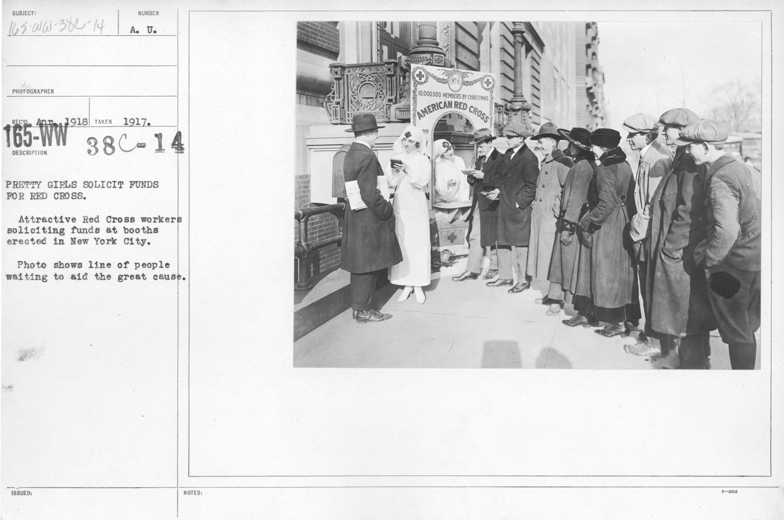 American Red Cross - Soliciting Funds - Personal Appeal - Pretty girls solicit funds for Red Cross. Attractive Red Cross workers soliciting funds at booths erected in new York City. Photo shows line of people waiting to aid the great cause