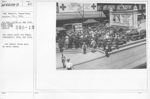 American Red Cross - Soliciting Funds - Public Gatherings - Red Cross drive for funds, Cincinnati, Ohio, May 1918. Old rubber tires sold to raise funds