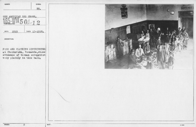 American Red Cross - Supplies - Food and clothing distributed at Chernavoda, Roumania, shows evidence of German occupation very plainly in this hall