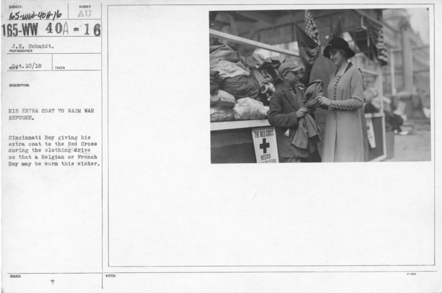 American Red Cross - Supplies - His extra coat to warm war refugee. Cincinnati Boy giving his extra coat to the Red Cross during the clothing drive so that a Belgian or French Boy may be warm this winter
