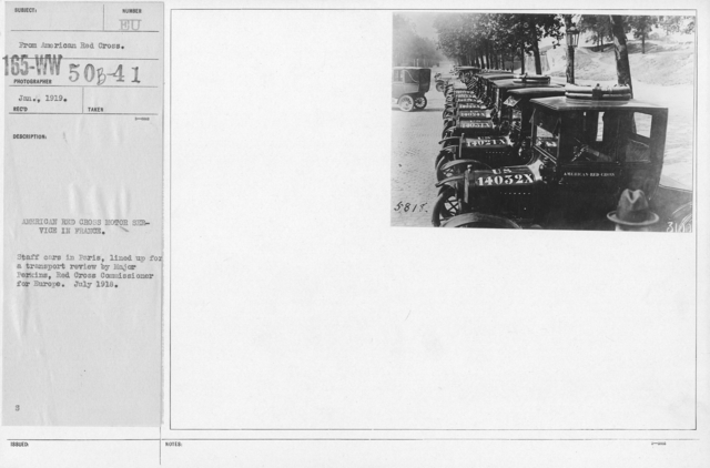 American Red Cross - Vehicles - American Red Cross Motor Service in France. Staff cars in Paris, lined up for a transport review by Major Perkins, Red Cross Commissioner for Europe. July 1918