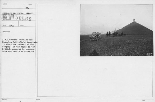 American Red Cross - Vehicles - A.R.C. workers crossing the Waterlook Battlefield immediately after the retreat of the Germans. On the right is the British monument to commemorate the battle of Waterloo