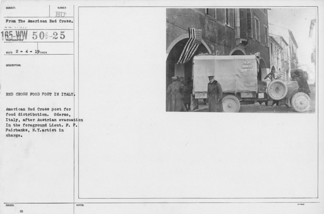 American Red Cross - Vehicles - Red Cross food post in Italy. American Red Cross post for food distribution. Oderzo, Italy, after Austrian evacuation. In the foreground Lieut. F.P. Fairbanks, N.Y. artist in charge