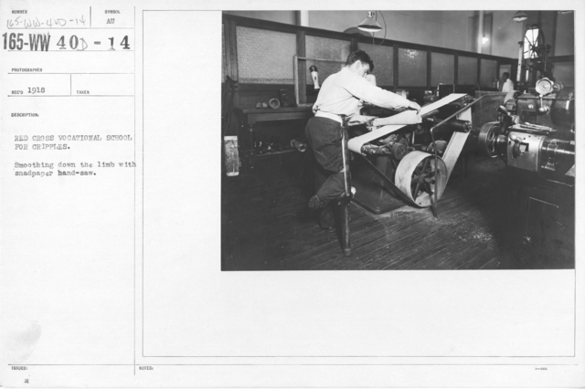 American Red Cross - War Work - Red Cross Vocational School for cripples. Smoothing down the limb with sandpaper hand-saw