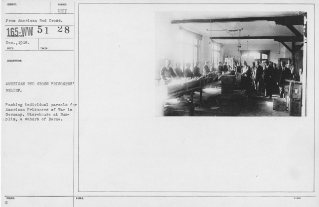 American Red Cross - Warehouses - American Red Cross Prisoners' Relief. Packing indvidual parcels for American Prisoners of War in Germany. Storehouse at Bumpliz, a suburb of Berne
