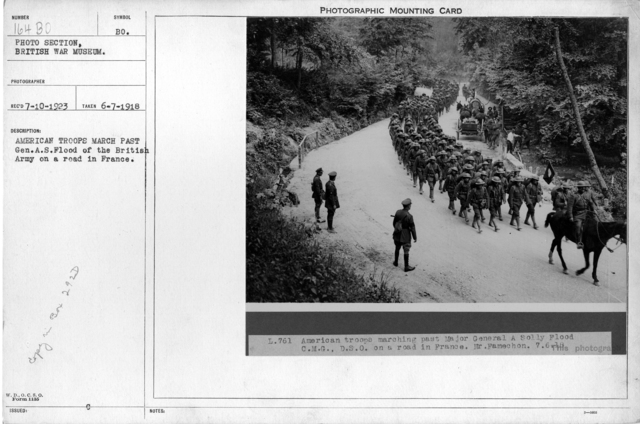 American troops march past Gen.A.S. Flood of the British Army on a road in France